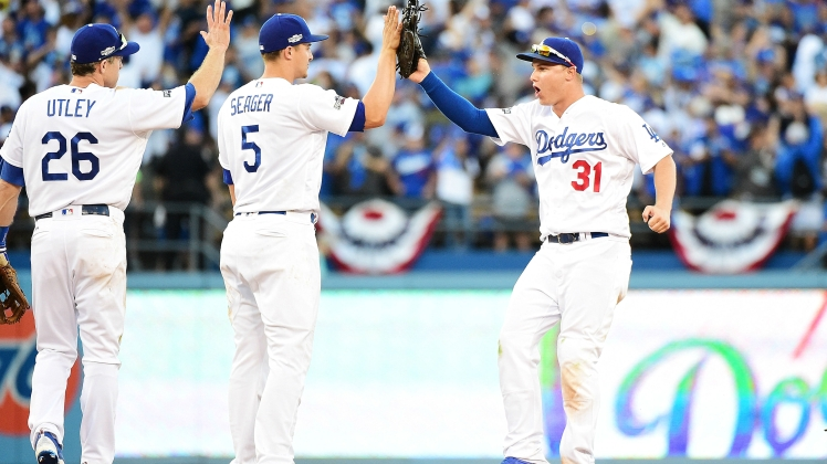 chase-utley-corey-seager-and-joc-pederson-celebrate-dodgers-win_rduabjkta88m1cwkzdihyjj5i